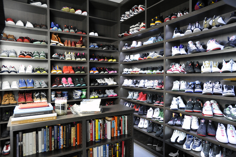 Numerous Athletic Shoes Are On Display In The Large Walk Shoe Closet Of