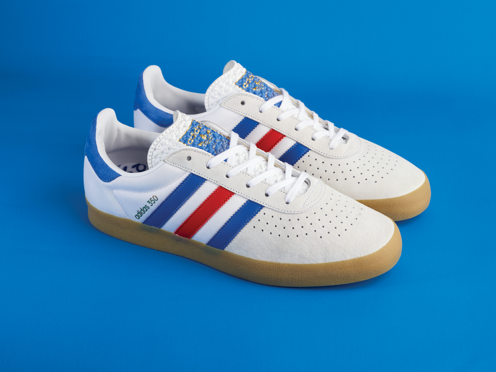 Alongside a navy blue iteration, featuring vibrant red and white stripes, adidas  Originals pays its dues to a host of previous releases by adorning the ...