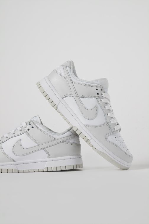 The Nike Dunk Low returns with a minimal 'Photon Dust' guise